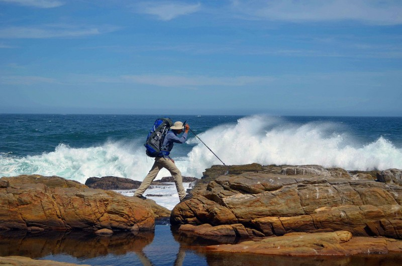 Waves crashing against rocks along the Otter Trail